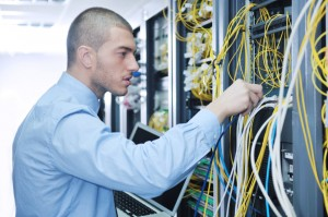 Computer service engineer in server room